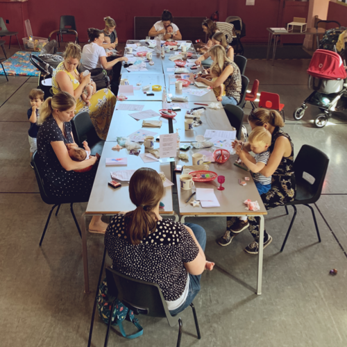 Mums and babies attending the Fathers' Day Fingerprint Workshop